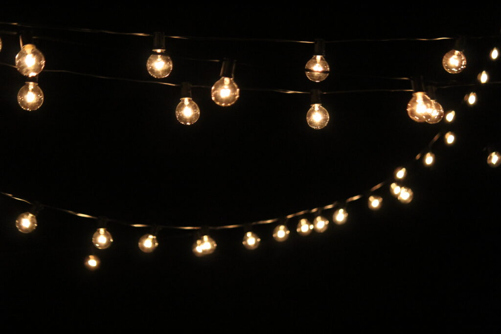 string lights over backyard fire pit